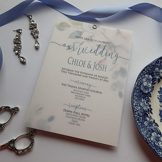 Vellum style wedding invitation with floral print.