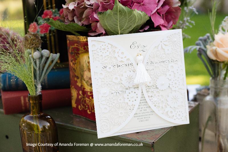 Lasercut wedding invitation with tassle