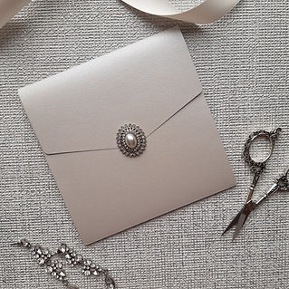 Pale silver pearlescent pocketfold invite