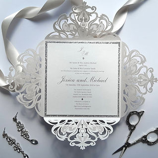 Beautiful Lasercut Wedding Invitation with silver glitter edging and diamantes.