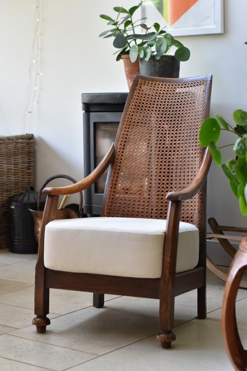 // Cane chair with sprung box cushion seat.