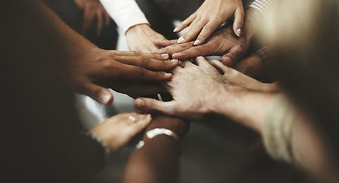 People with joined hands as a team.jpg