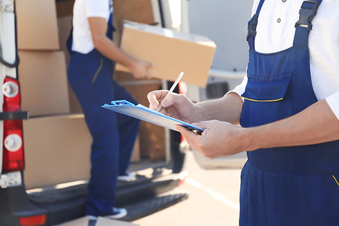 Delivery man checking list on clipboard
