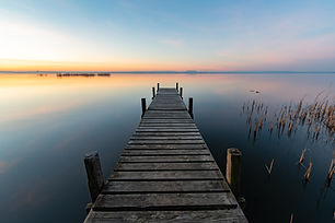 Pier at clear sunrise at Steinhuder Meer