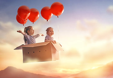 Dreams of travel! Two children are flyin