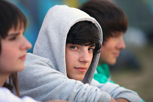 Three teenagers sat together.jpg