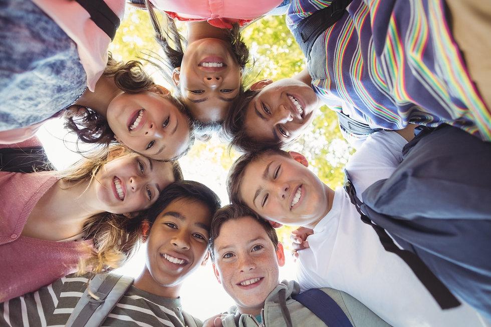 Portrait of smiling school kids forming