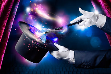 Magician hand with magic wand and hat.jp