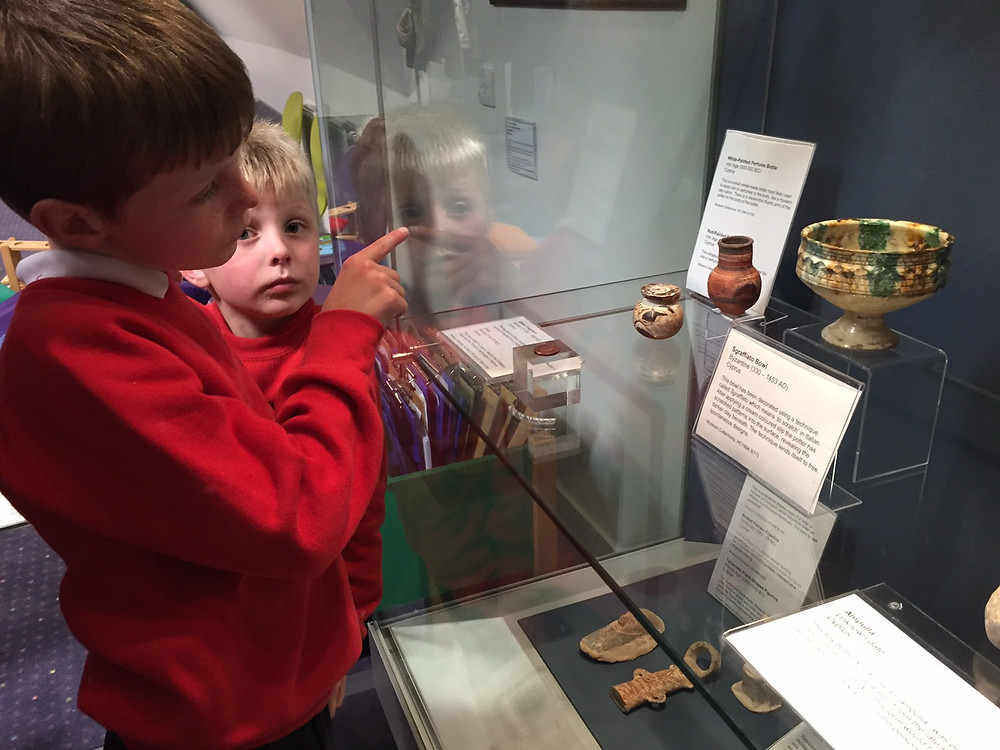 young learners engage with museum display (c) University of St Andrews Museum (MUSA). Used with permission.