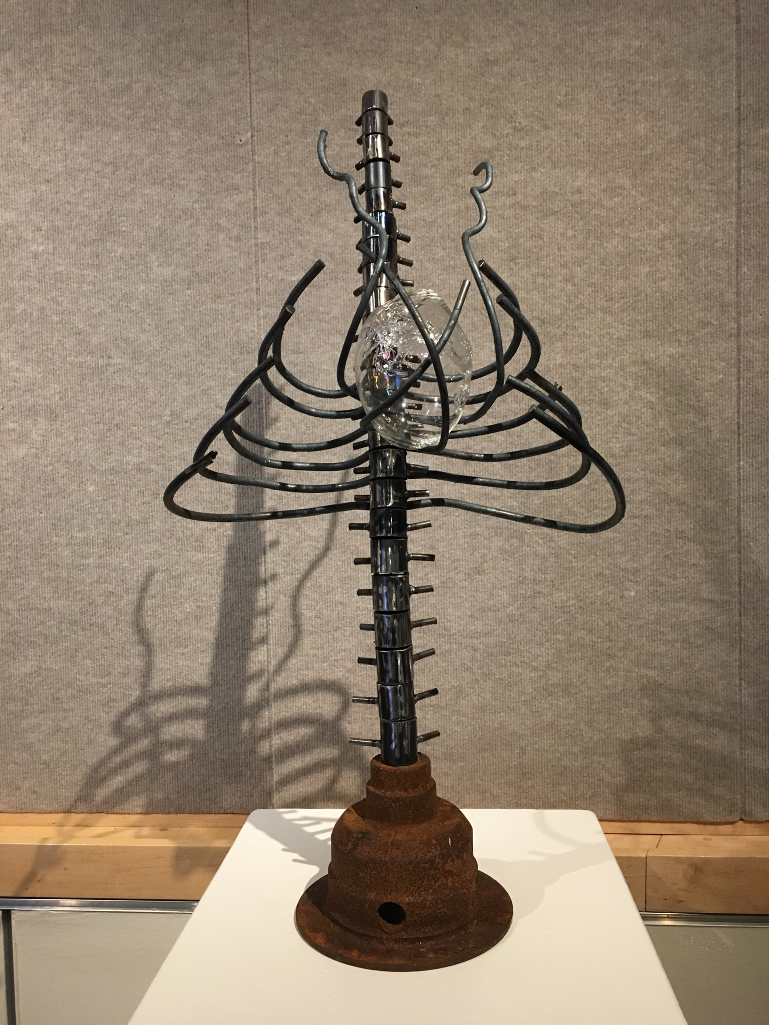 steel rib/ spine with glass heart