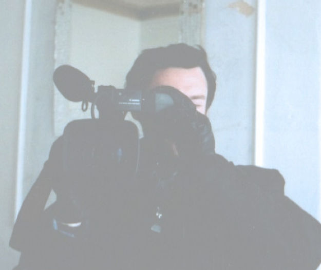 post graduate with digital camera filmed on set shooting short film