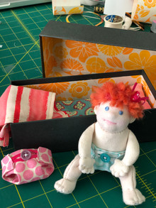 Baby doll in box bed