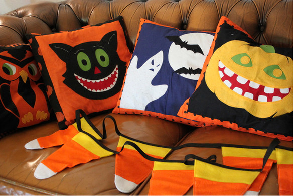Halloween pillows and candy corn garland