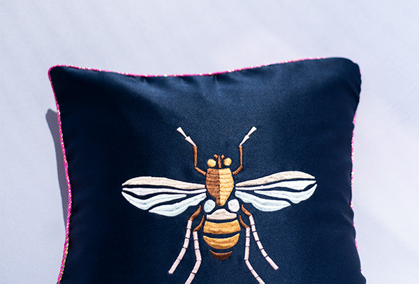 Insect embroidered cushion cover
