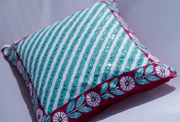 Striped sequin cushion cover