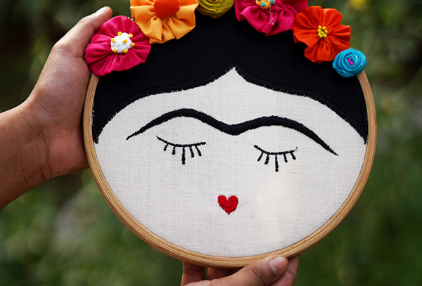 Freida embroidered wall hanging with fabric flowers