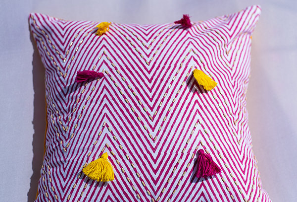Chevron beadwork cushion cover with tassel