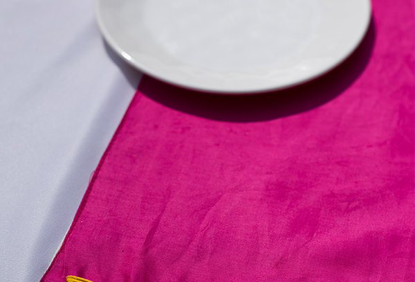 Embroidered hot pink table mat
