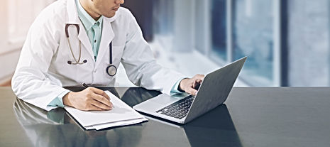 Doctor working with laptop computer and