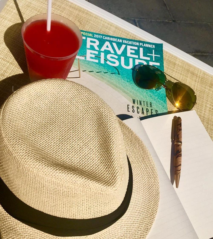 mexico travel writer hat sunglasses