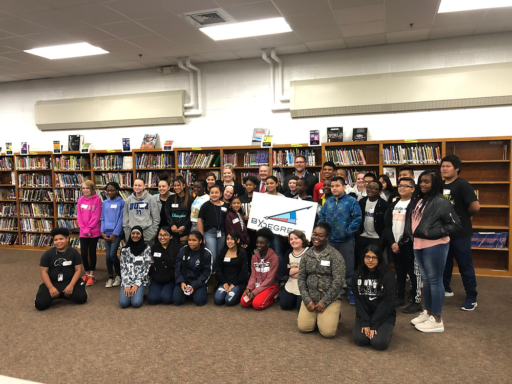 Group of Harding students pose for a photo with By Degrees CEO Emily Westergaard, State Treasurer Michael Fitzgerald, and Des Moines Public Schools Superintendent Dr. Tom Ahart.
