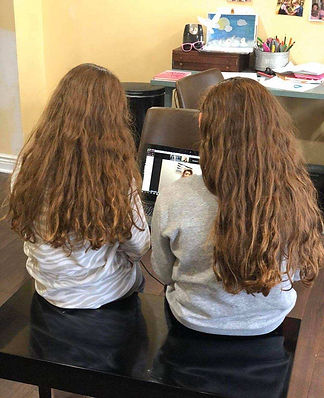 Sisters taking a virtual music lesson
