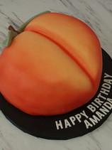 How cute is this custom 🍑 birthday cake