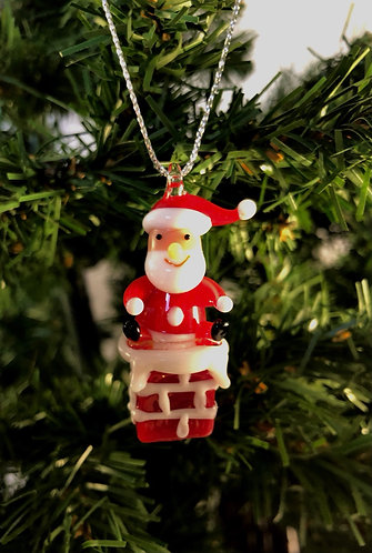 Glass Santa on Chimney.