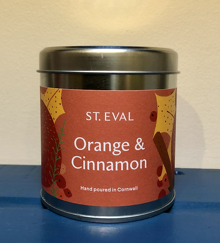 Orange and Cinnamon Scented Candle.