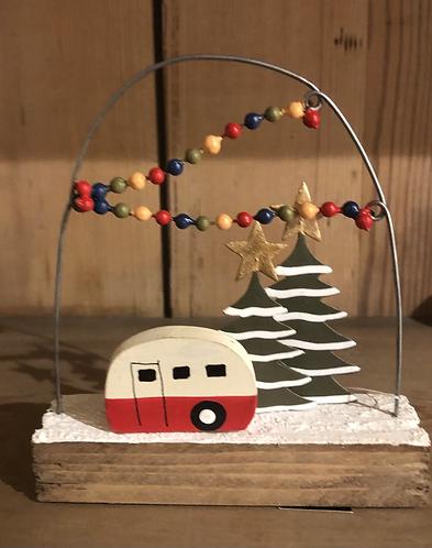 Festive caravan on wooden block