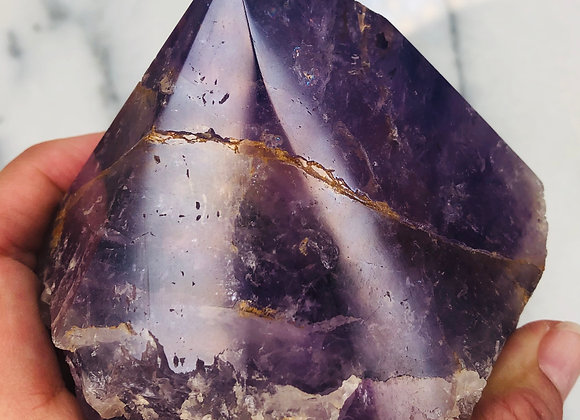 image of amethyst point crystal specimen with flat bottom displayed over white background