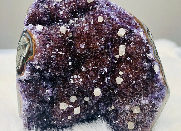 image of amethyst geode cathedral crystal specimen displayed over white background