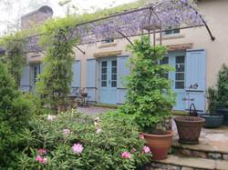 Mountain residence arbor in bloom