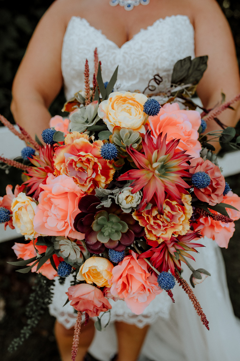 fake flower wedding bouquet with coral and blue, photo by detroit wedding photographer little blue bird photography
