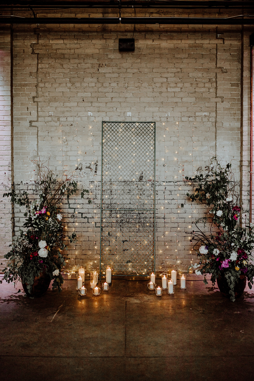 wedding ceremony backdrop at the eastern market in detroit, michigan - photo taken by little blue bird photography