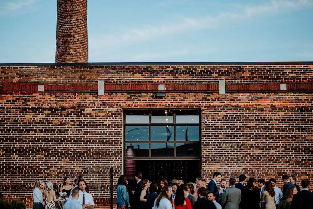 wedding at the eastern market in detroit, michigan. photo by little blue bird photography