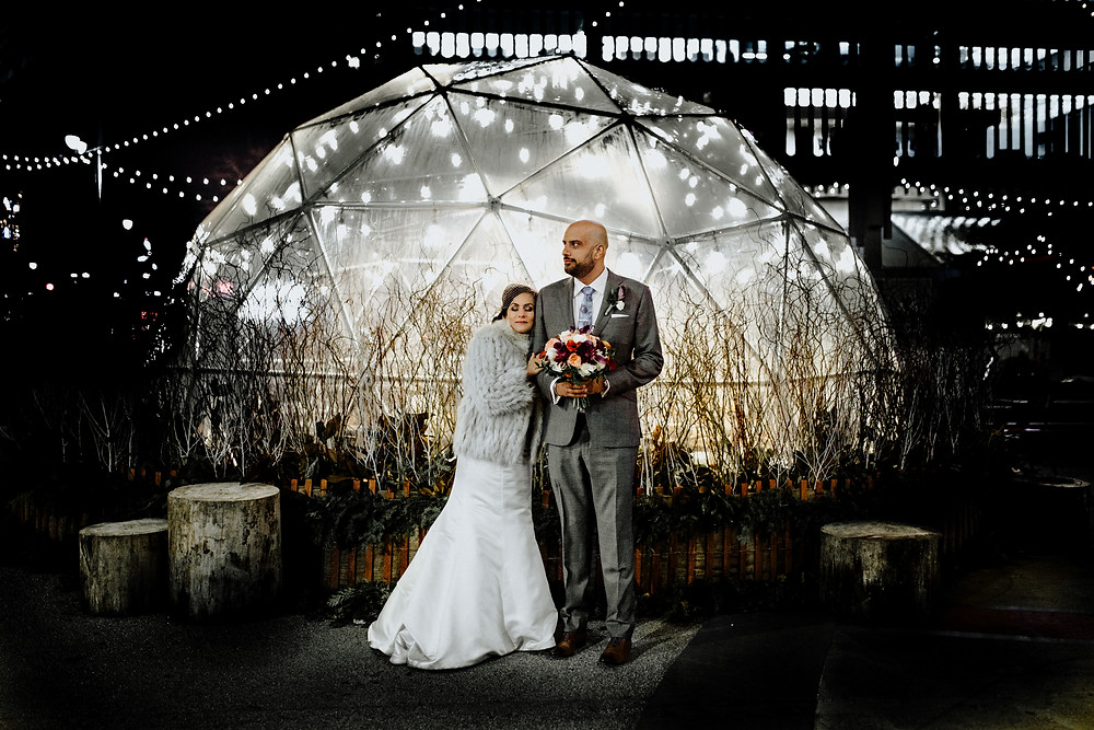 night wedding photo in downtown detroit. photo taken by little blue bird photography