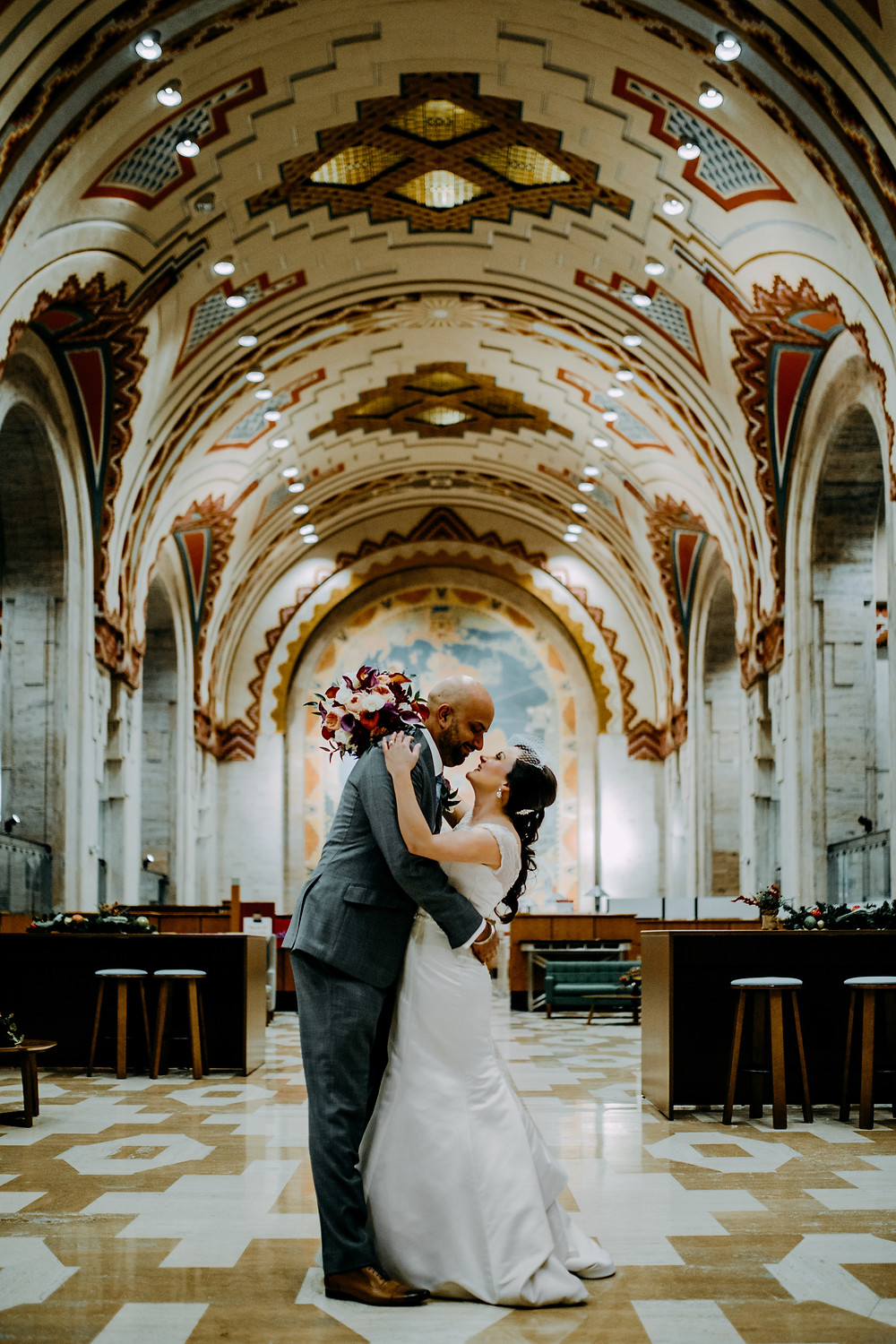elopement photo at the guardian building in downtown detroit taken by little blue bird photography.