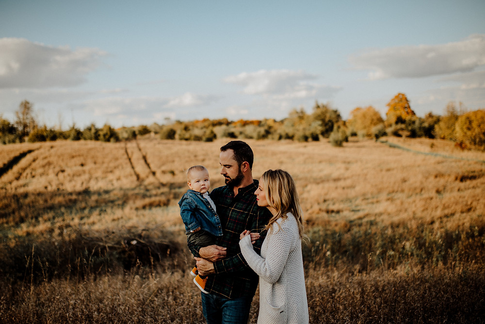 fall family photos taken in a field at golden hour - photos taken by Detroit wedding photographer Little Blue Bird Photography in Manitou Beach, Michigan