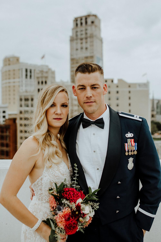 artistic wedding photo with detroit skyline taken by detroit wedding photographer little blue bird photography.