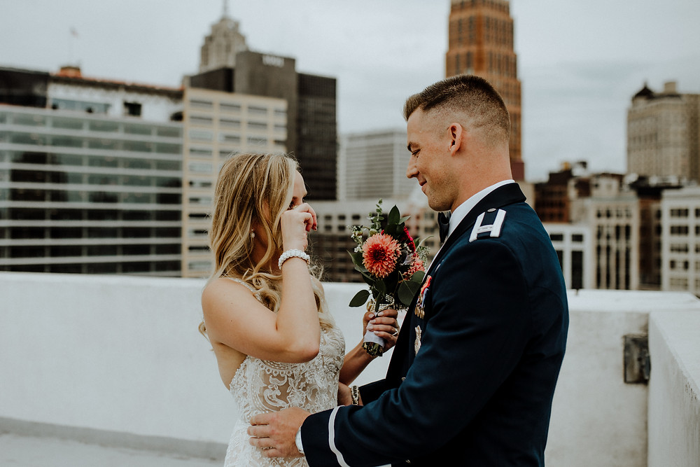first look wedding photo on top of zdeck in detroit. photo taken by wedding photographer little blue bird photography.