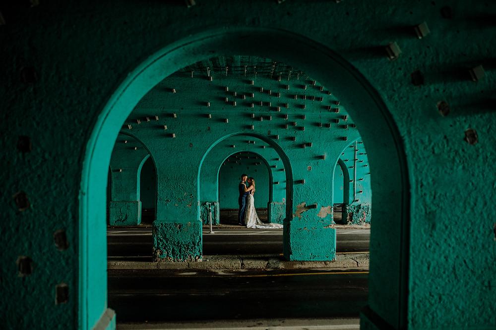 creative wedding photo at cass reflector in detroit taken by little blue bird photography.