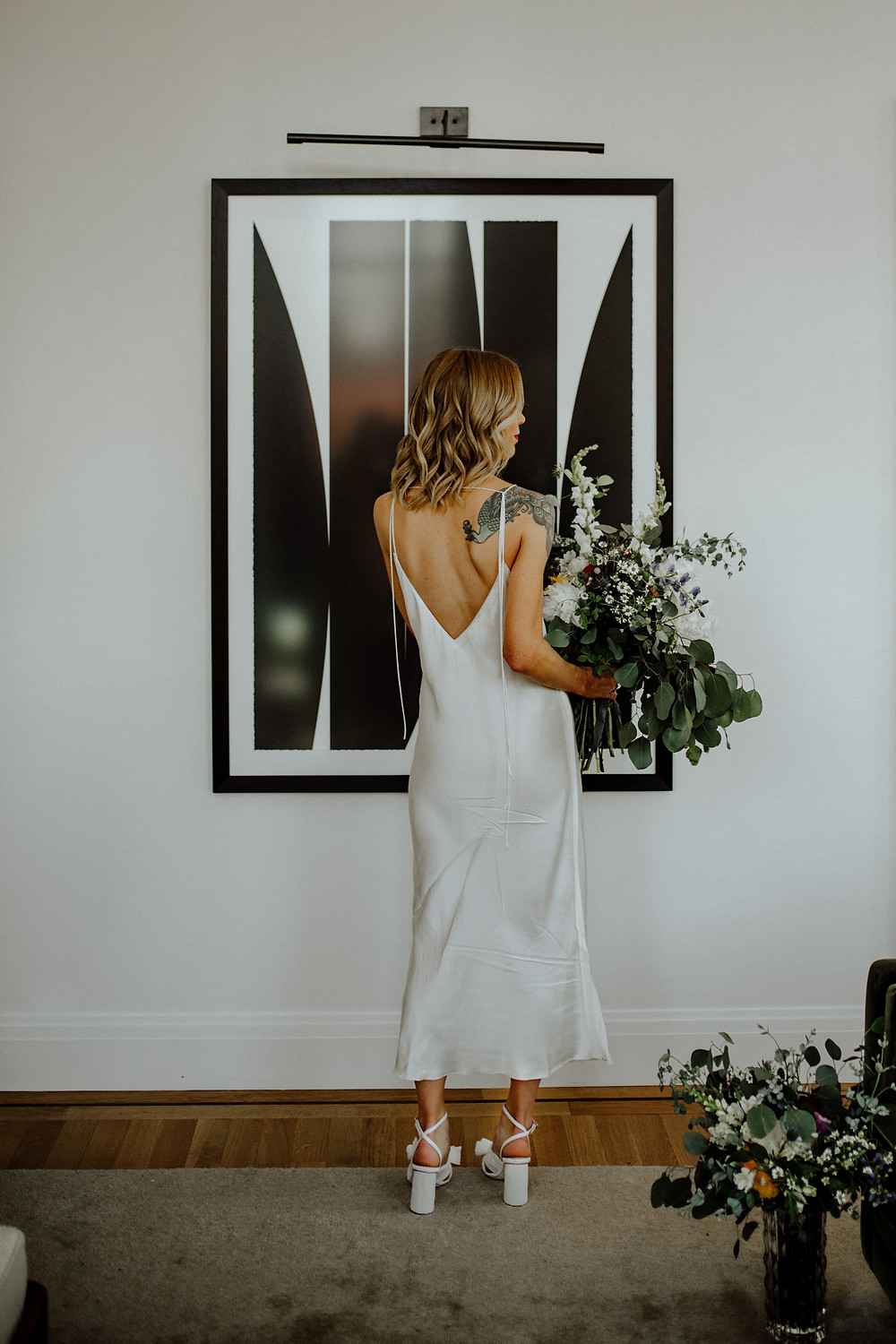 bride with tattoos photo taken by detroit elopement photographer, little blue bird photography at shinola hotel in detroit, michigan