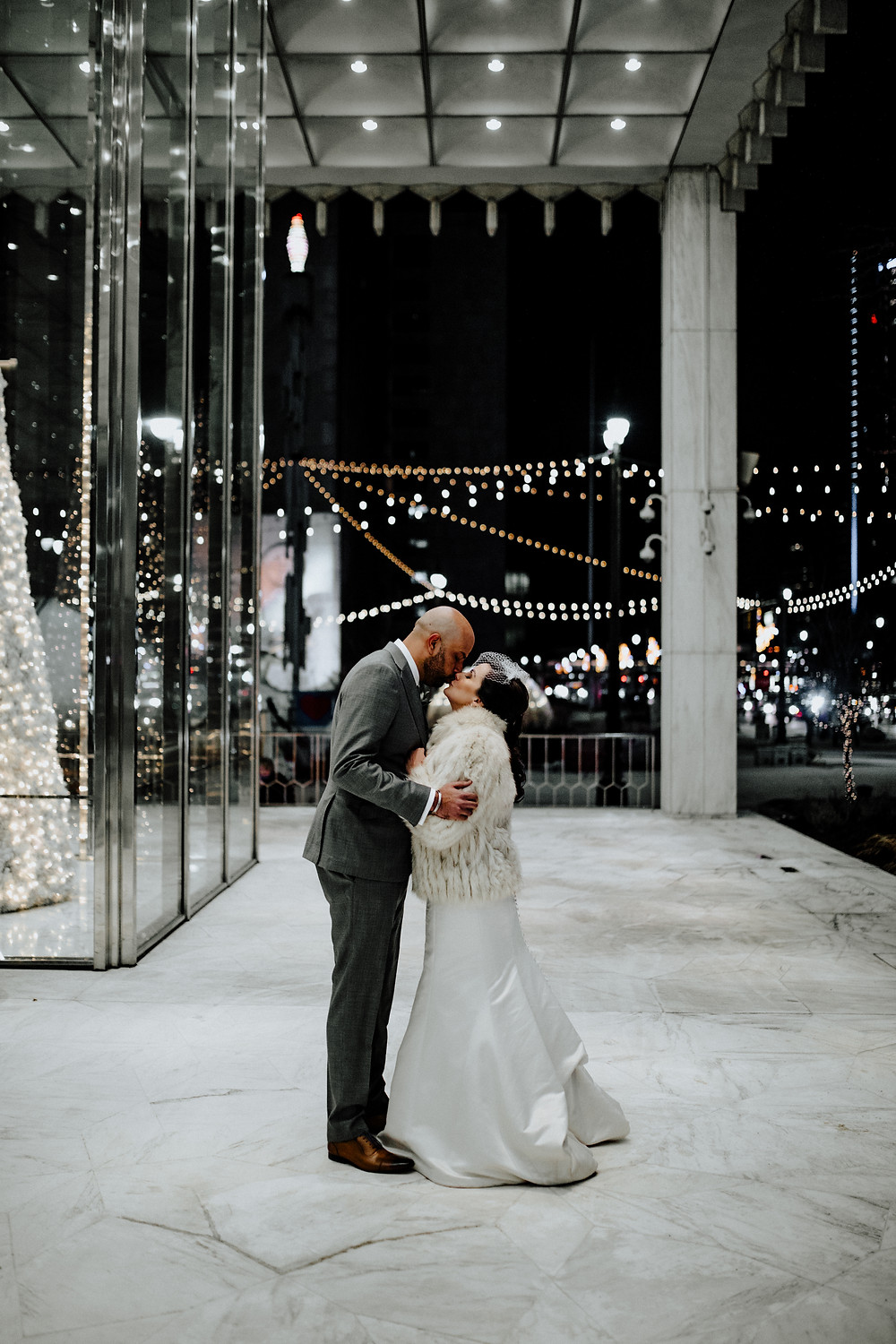 night wedding photo taken in downtown detroit by little blue bird photography.
