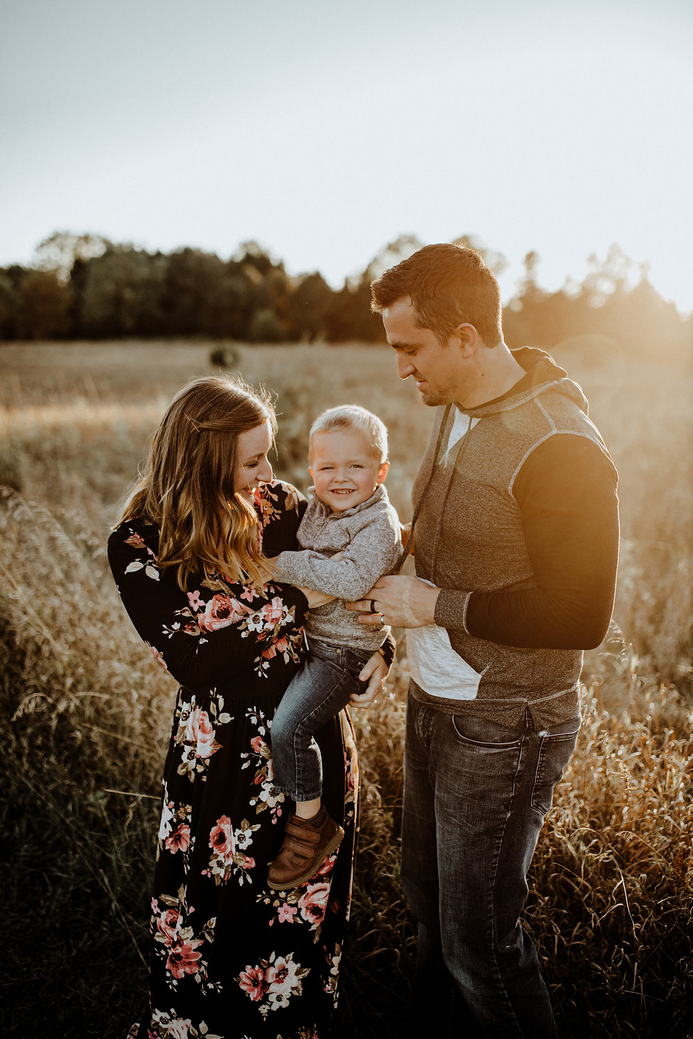 fall family photo in a field - taken by family photographer Little Blue Bird Photography in Manitou Beach, Michigan
