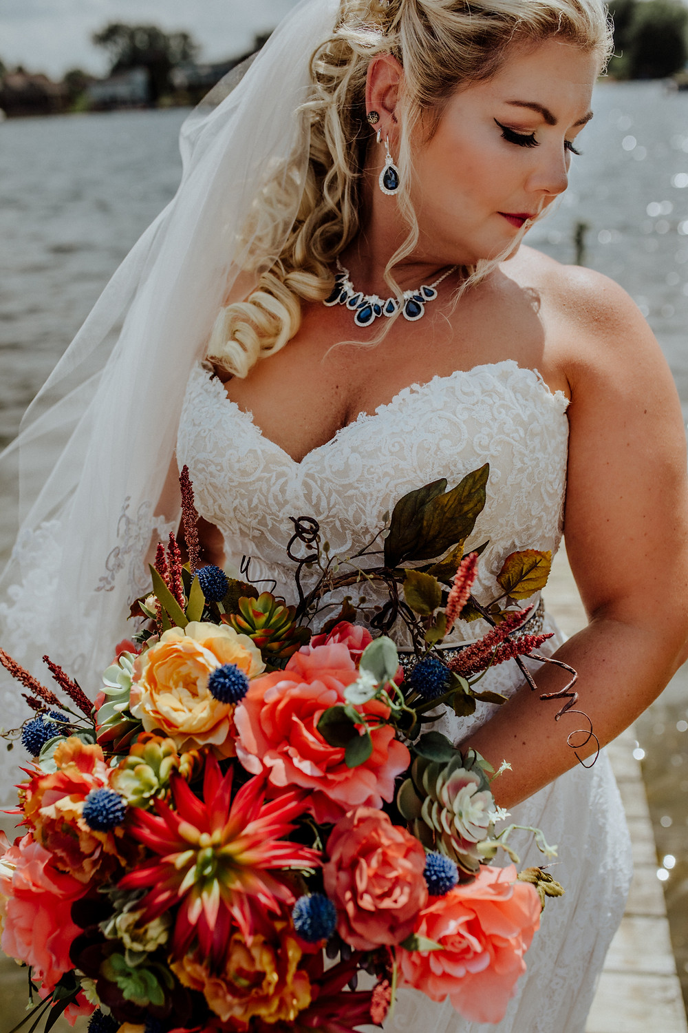 bridal portrait by a lake, photo by detroit area wedding photographer little blue bird photography in somerset, michigan