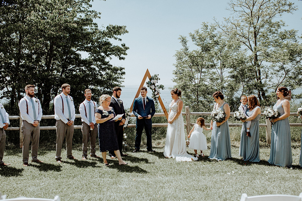 candid wedding photo taken by ann arbor wedding photographer, little blue bird photography in manistee, michigan.