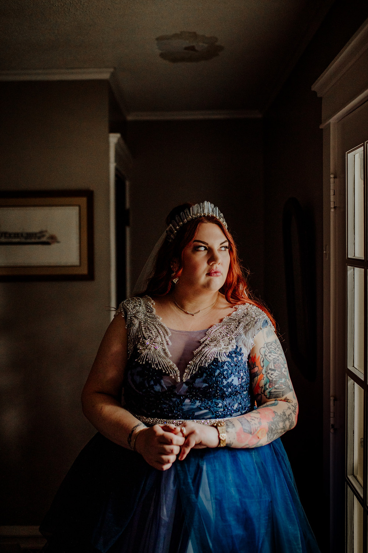 custom blue wedding dress photo taken by little blue bird photography in jackson, michigan.