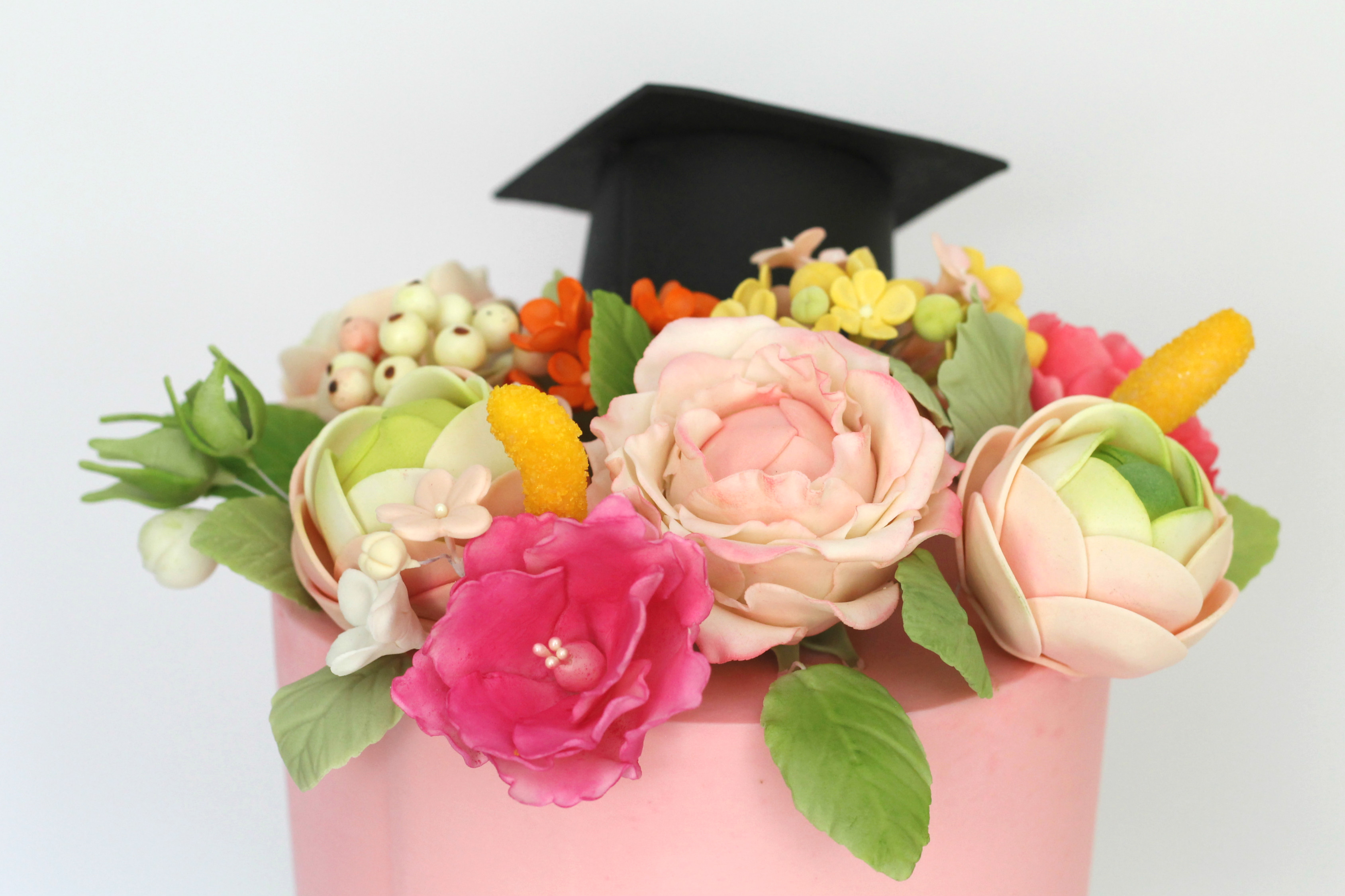 top of floral grad cake