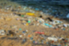 Plastic litter on the beach and sea